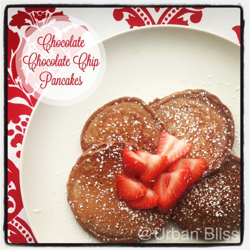 Chocolate chocolate chip pancakes are a decadent, delicious way to celebrate special mornings! Recipe on UrbanBlissLife.com