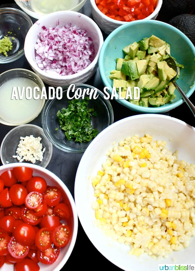 Avocado, tomatoes, corn, red onions in bowls