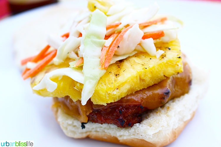 landscape photo of teriyaki turkey burger with asian pineapple slaw