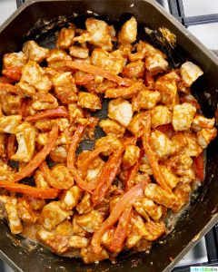 pork and red peppers in skillet