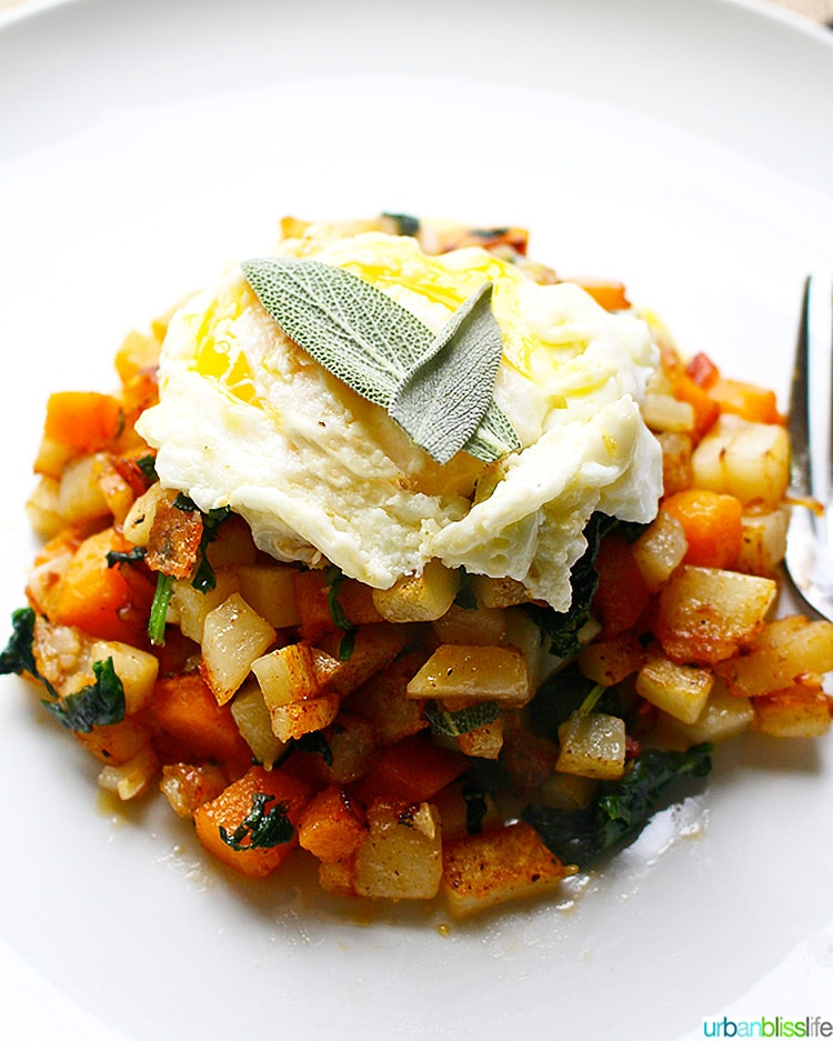 Butternut Squash Hash topped with sage and egg, close up