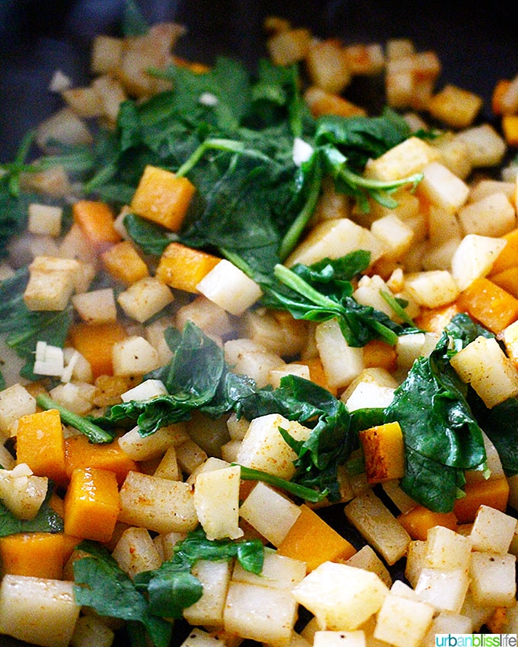 butternut squash hash cooking with spinach