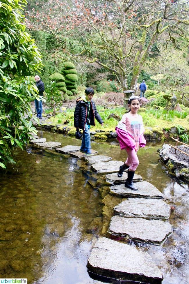 kids crossing pond at Butchart Gardens