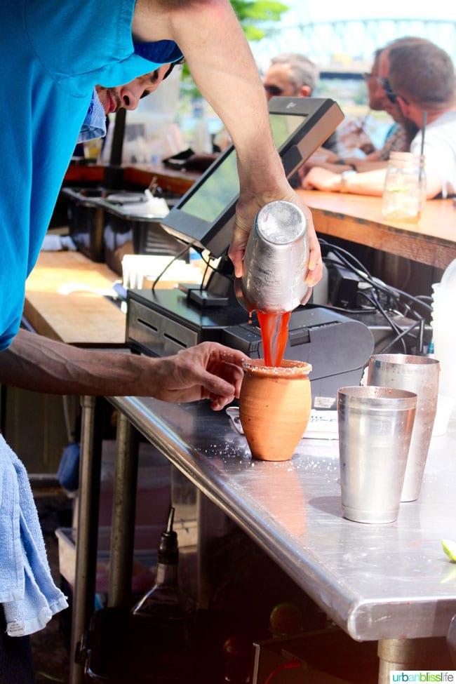 Bartender making spicy Strawberry Margarita