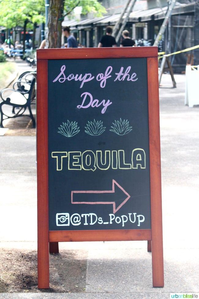 sandwich board with tequila on it