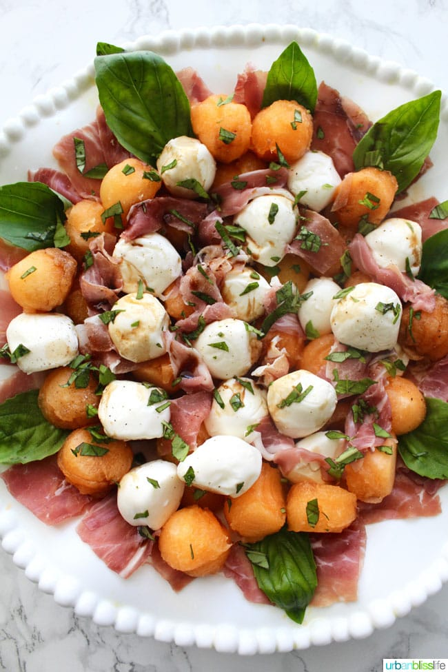 Summer Melon & Prosciutto Caprese Salad is perfect for barbecues and picnics! Recipe on UrbanBlissLife.com