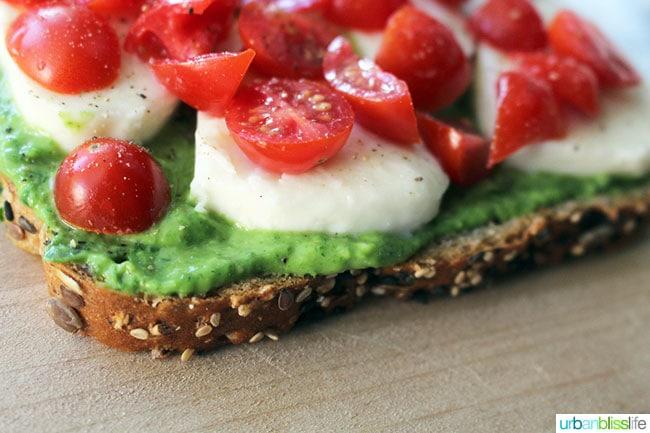 tomatoes, cheese and avocado pesto on bread