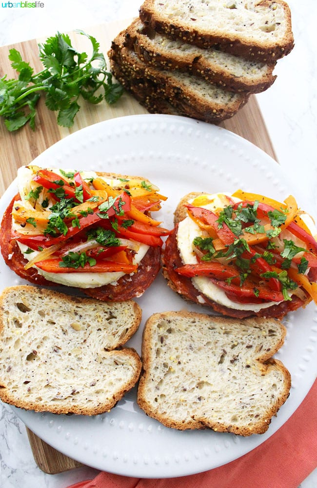 peppers, chorizo, herbs, and cheese on bread slices