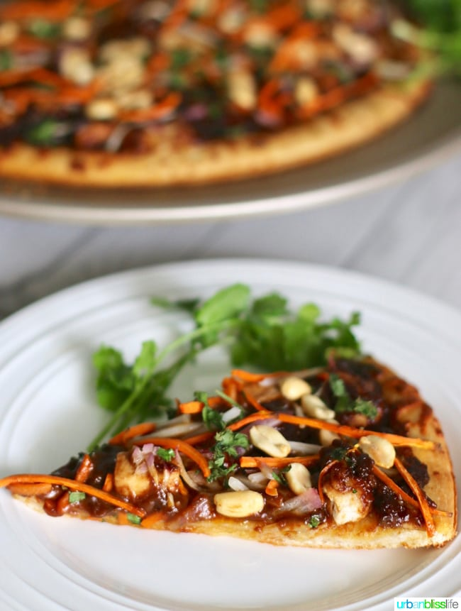 A super yummy, dairy-free, veggie-packed, ginger & garlic peanut sauce CPK Copycat Thai Chicken Pizza recipe on UrbanBlissLife.com