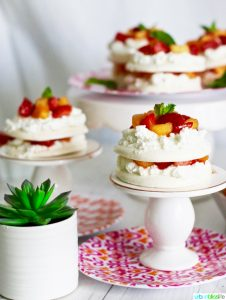 Mini Pavlova Cakes with Strawberries, Peaches, and Cream recipe on UrbanBlissLife.com