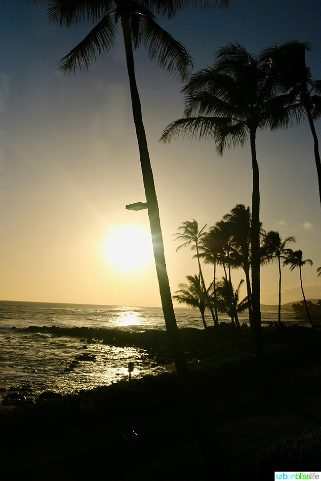Beautiful Hawaiian sunset on Poipu Beach in Kauai, Hawaii on UrbanBlissLife.com