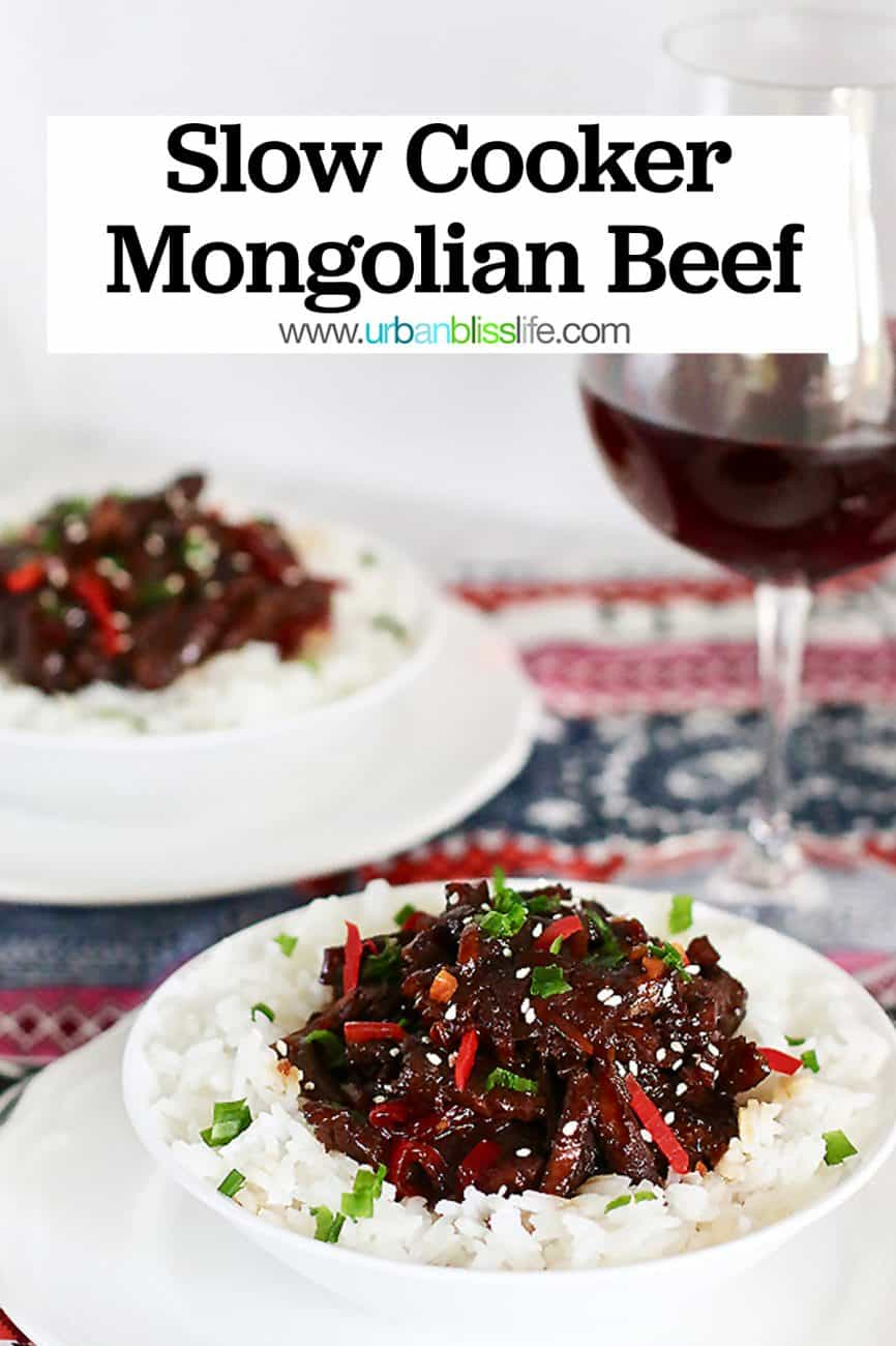 two bowls of Slow Cooker Mongolian Beef and glass of red wine