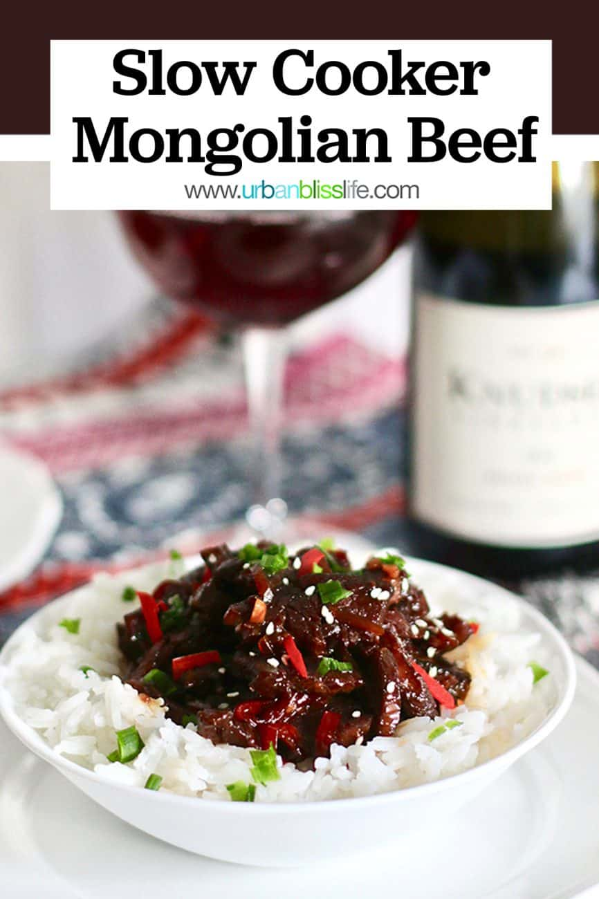 bowl of Slow Cooker Mongolian Beef with red wine and bottle