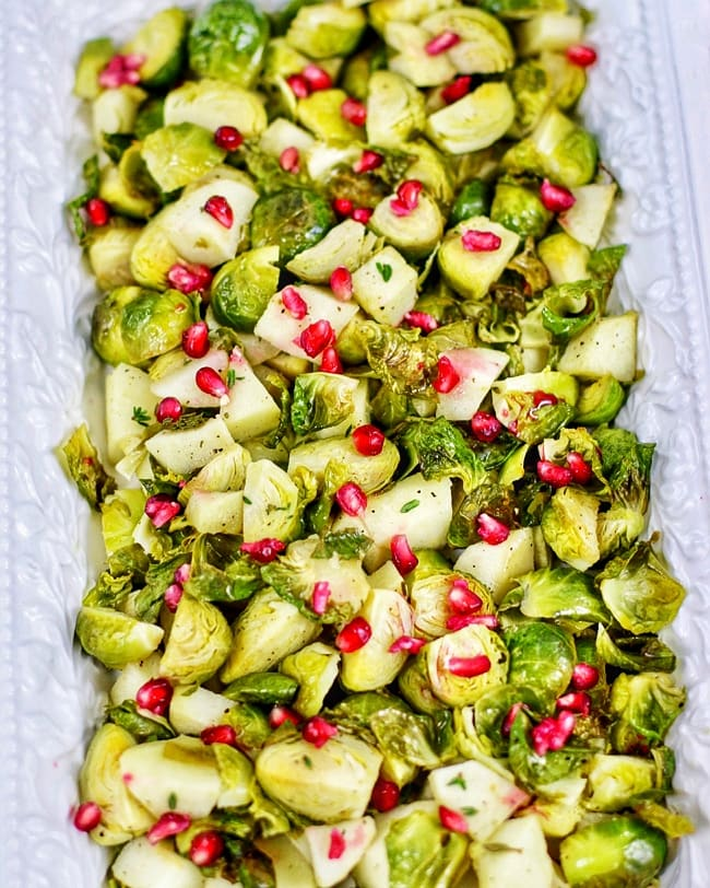 serving platter with roasted brussels sprouts, apples, pomegranate