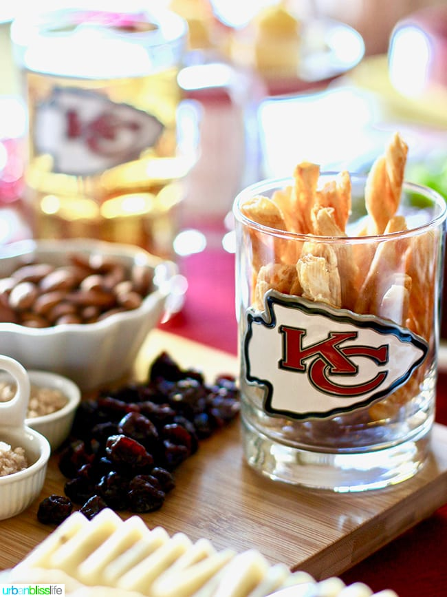 KC Chiefs glass with party food - Game Day Food and Drink Tips