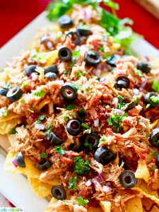 Slow Cooker Pulled Pork Nachos recipe on UrbanBlissLife.com