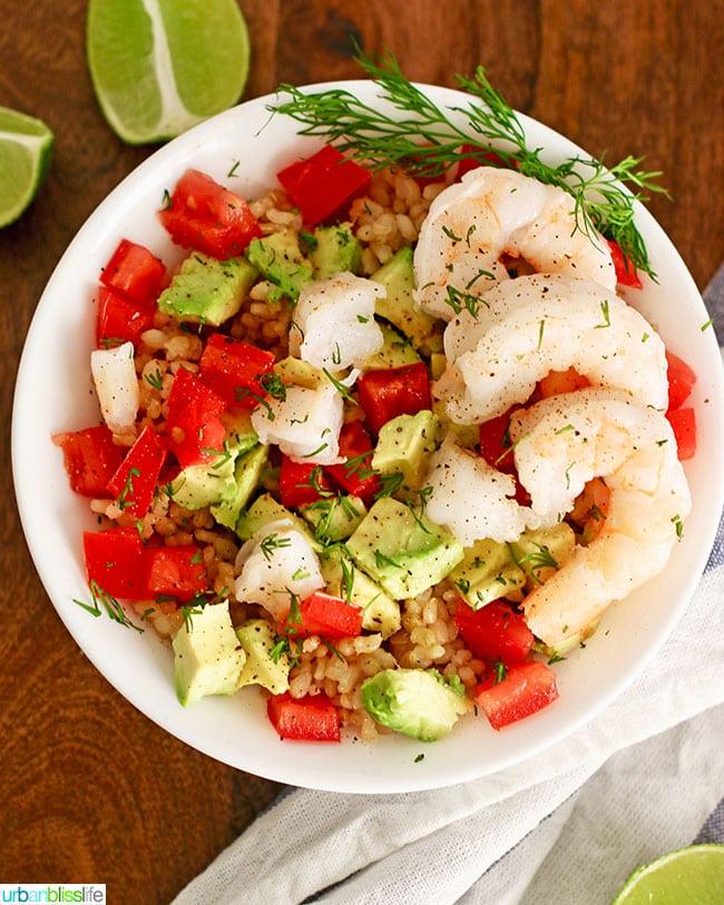 shrimp avocado rice bowl with limes