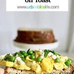 Scrambled eggs on toast with peas and feta