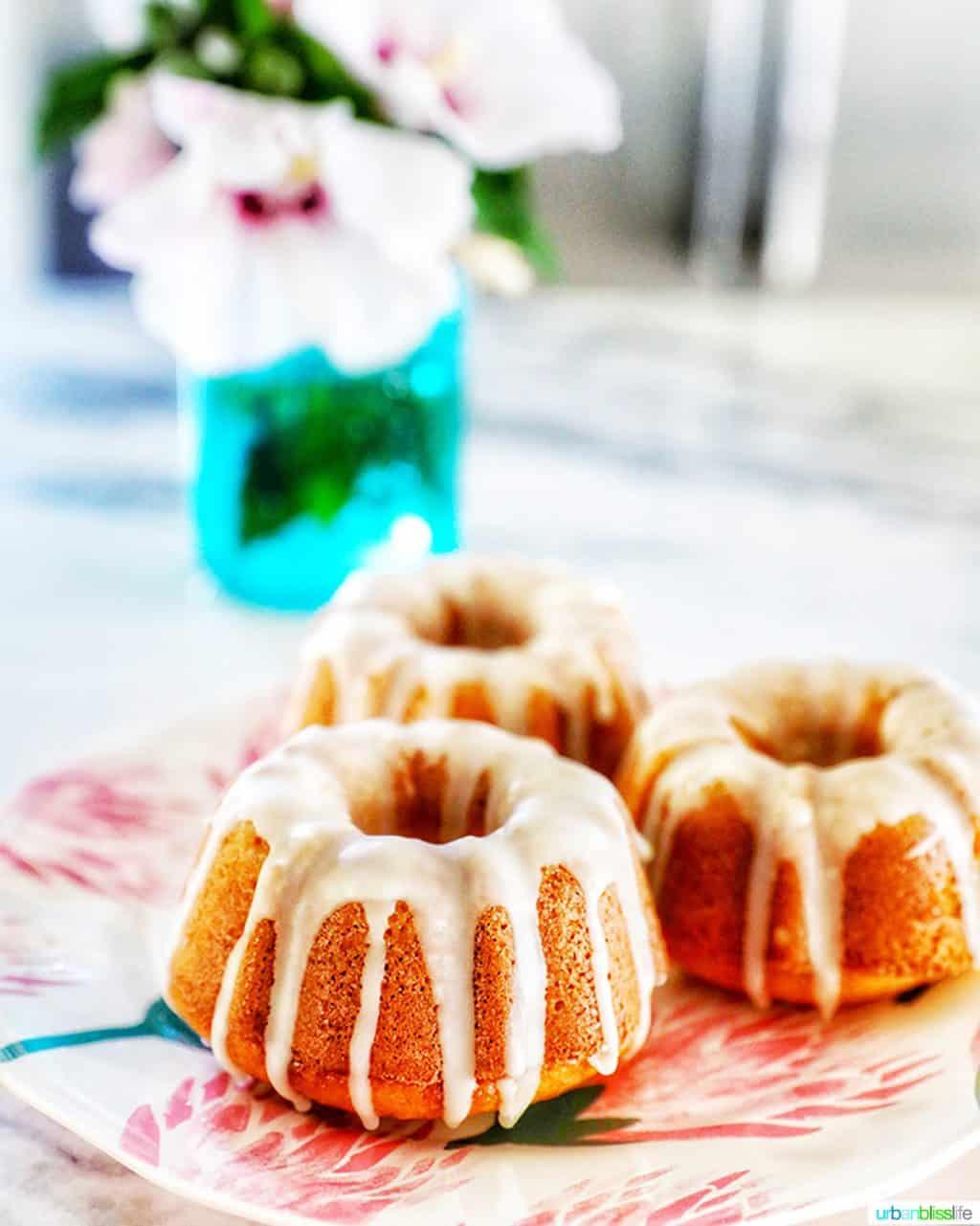 straight-on angle of three mini bundt cakes with citrus