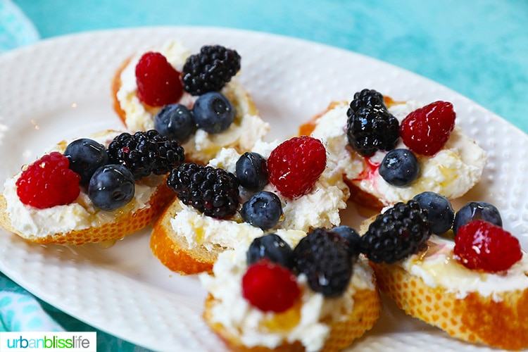landscape pic of ricotta crostini with summer berries
