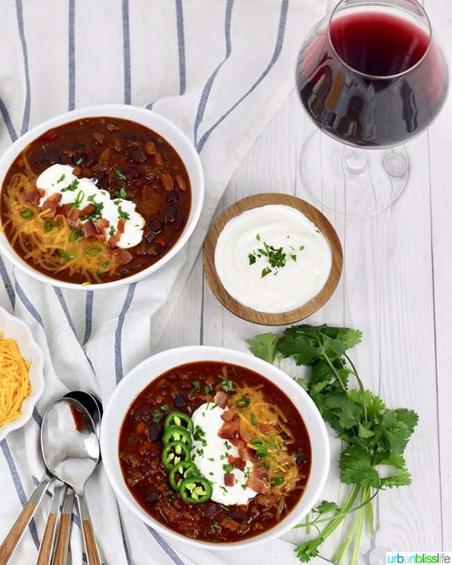 chili on bowls with red wine