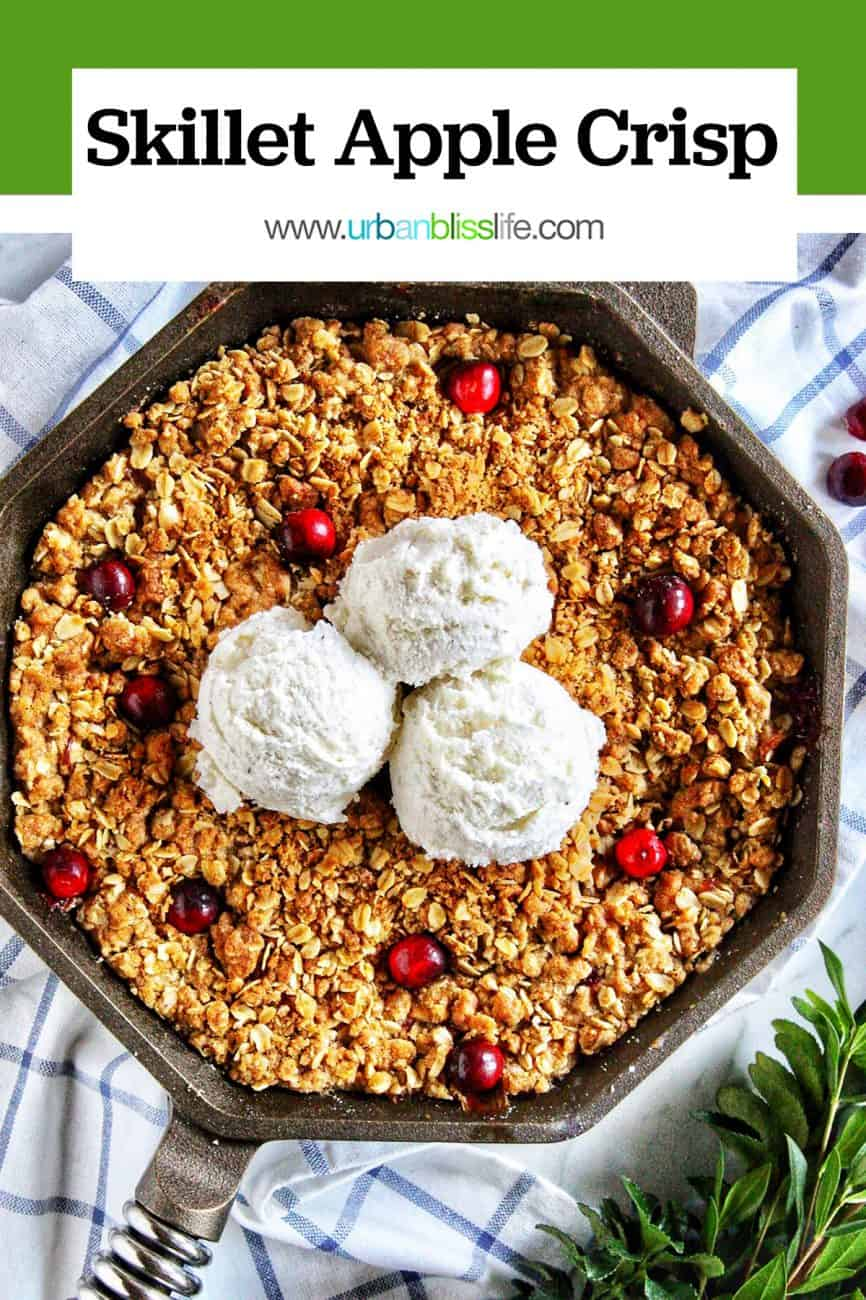 skillet apple cranberry crisp with three scoops of vanilla ice cream and green border title text overlay