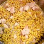 adding water to Dairy-Free Instant Pot Tuscan Chicken Pasta