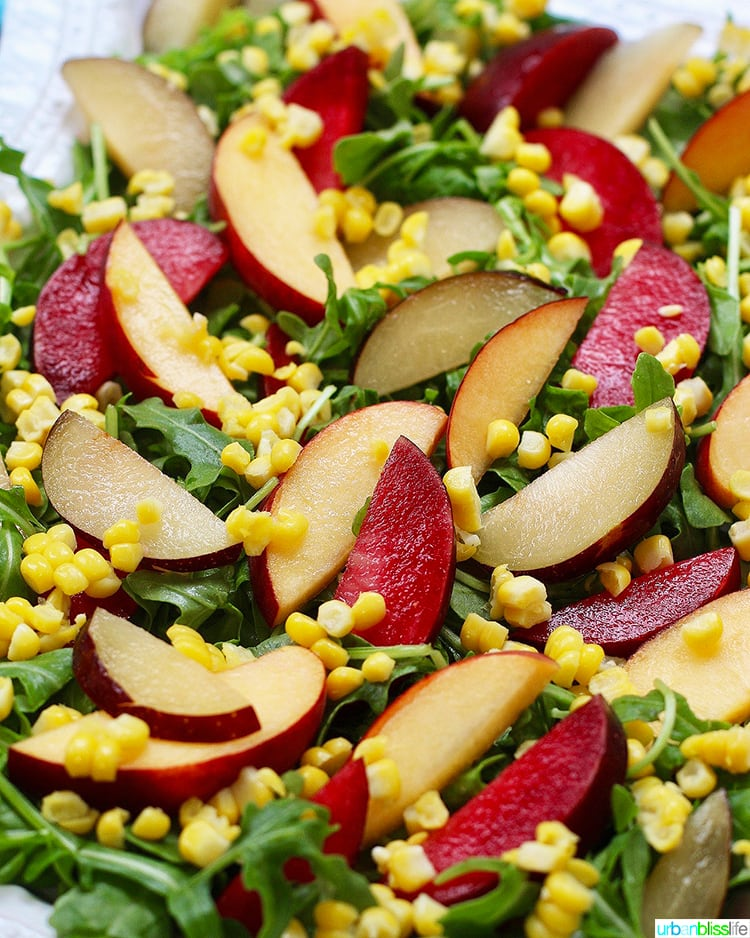 peaches, plums, corn, arugula salad