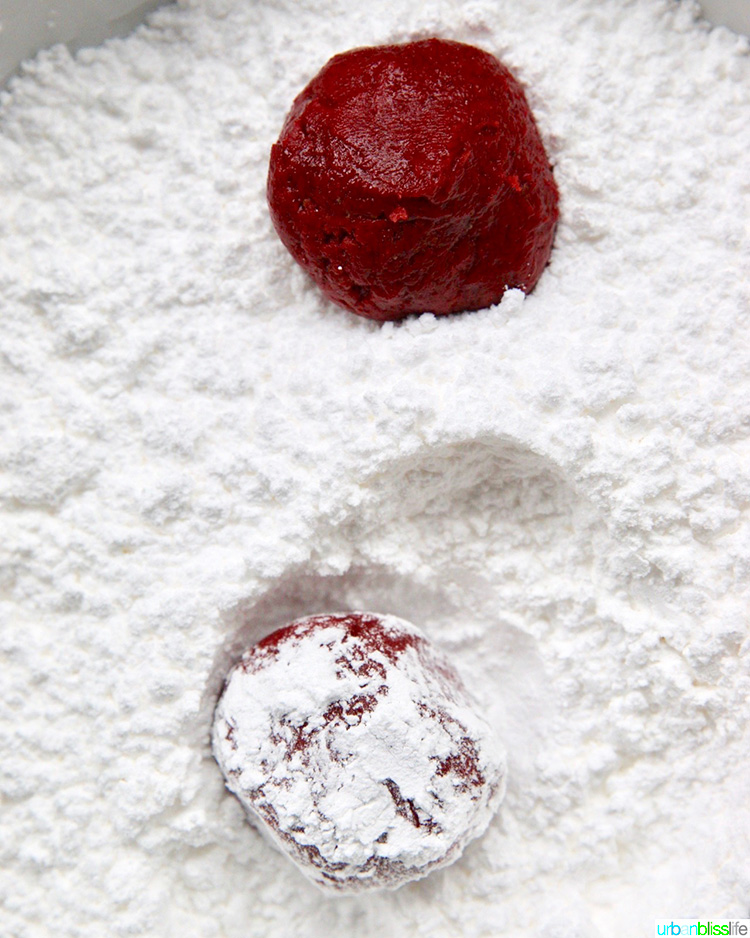 red velvet cookie dough rolled in powdered sugar