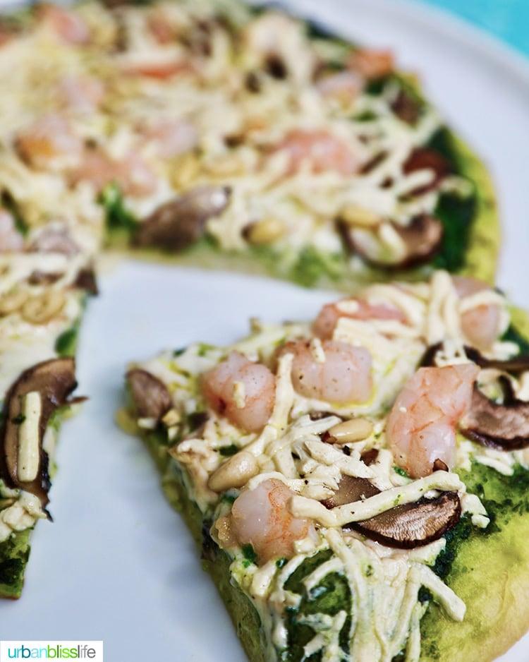 slice of shrimp pesto pizza