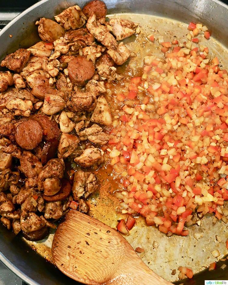 cooking seafood paella in a paella pan