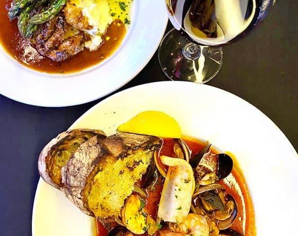 cioppino and pork tenderloin at Carina Lounge Portland Dining Month 2020 menu