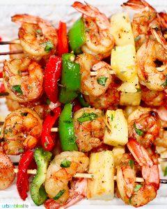 closeup of several grilled shrimp pineapple skewers served together