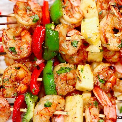 closeup of several grilled shrimp pineapple skewers served together