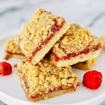 stack of Raspberry Crumble Bars on pedestal