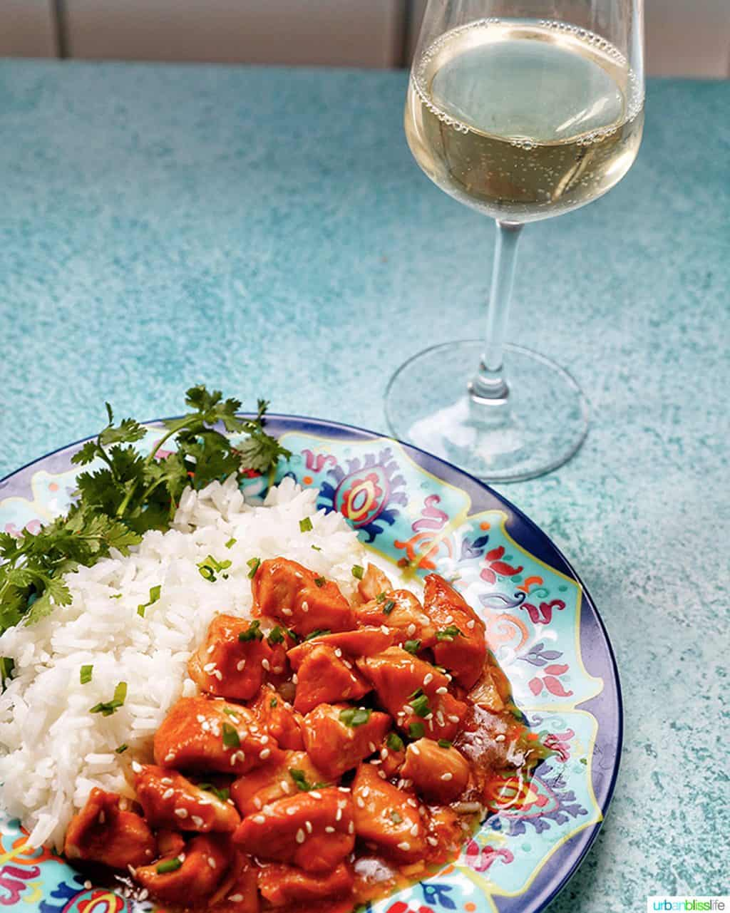 plate of Instant Pot Honey Garlic Chicken with glass of white wine