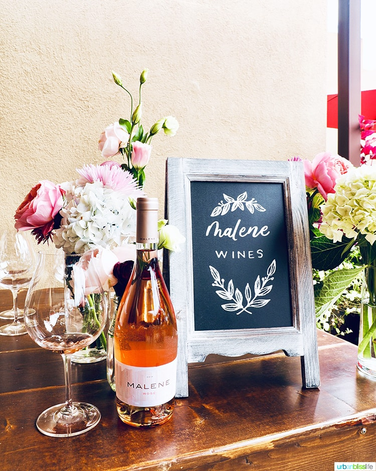 Malene Rosé bottle with flowers and wine glass