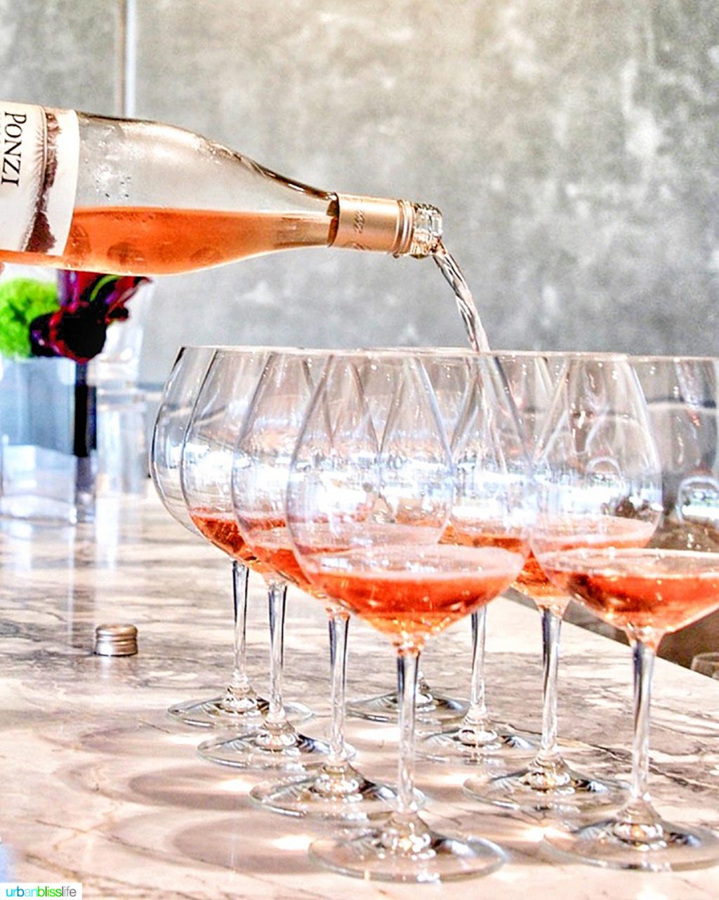 Ponzi rose wine pouring into wine glasses