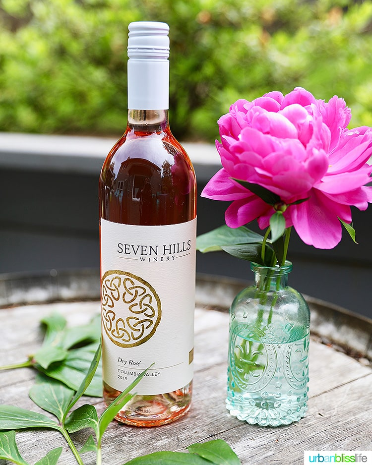 Seven Hills Winery 2019 Rosé wine bottle with pink flower in vase