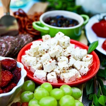 marinated feta as part of a spread with grapes