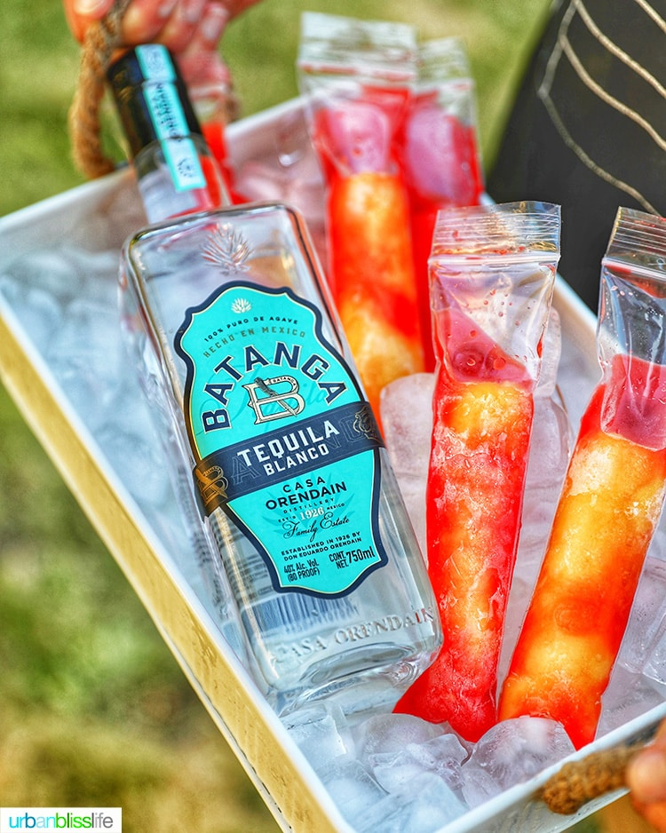 Batanga Tequila bottle withTequila Sunset Pops on ice tray