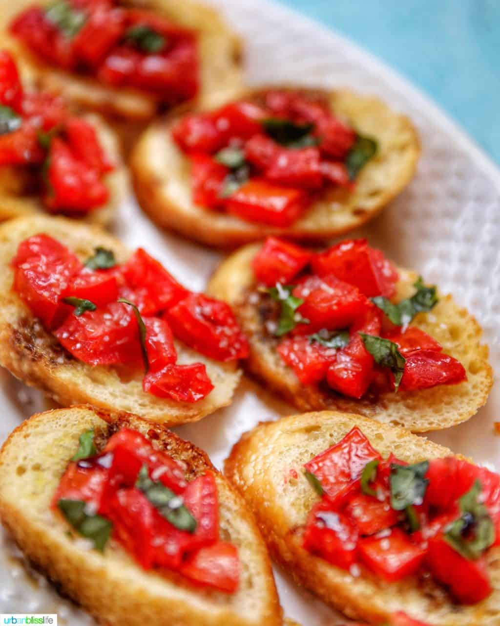 full plate of tomato bruschetta with balsamic vinegar