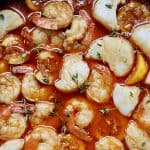 closeup of New Orleans-style BBQ shrimp and scallops