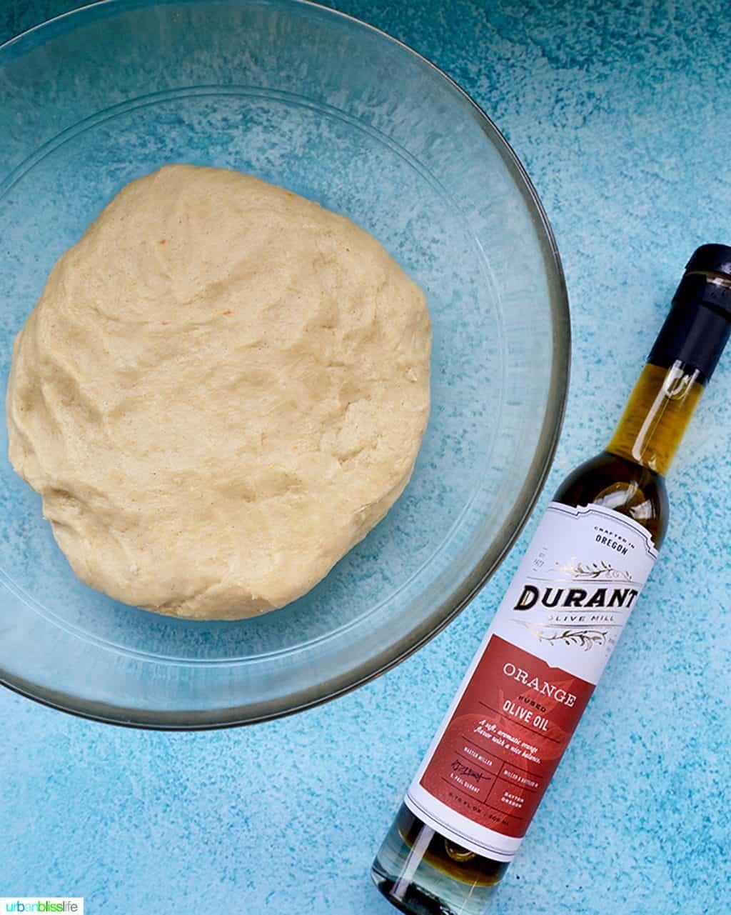 orange oilive oil with cinnamon roll dough