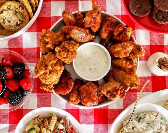 tailgating food on red checkered tablecloth