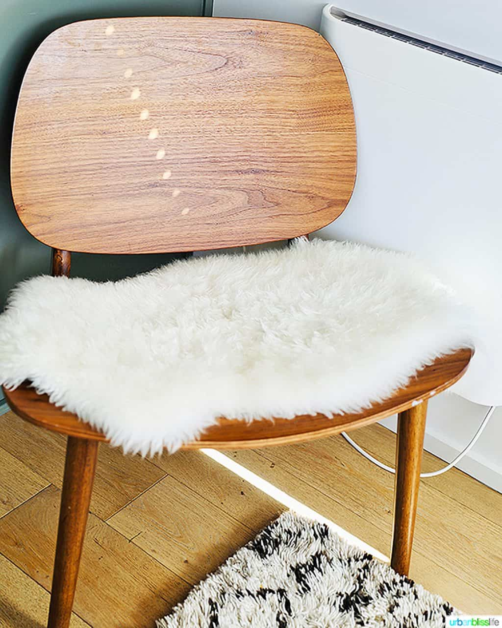 mid-century modern chair with fuzzy throw