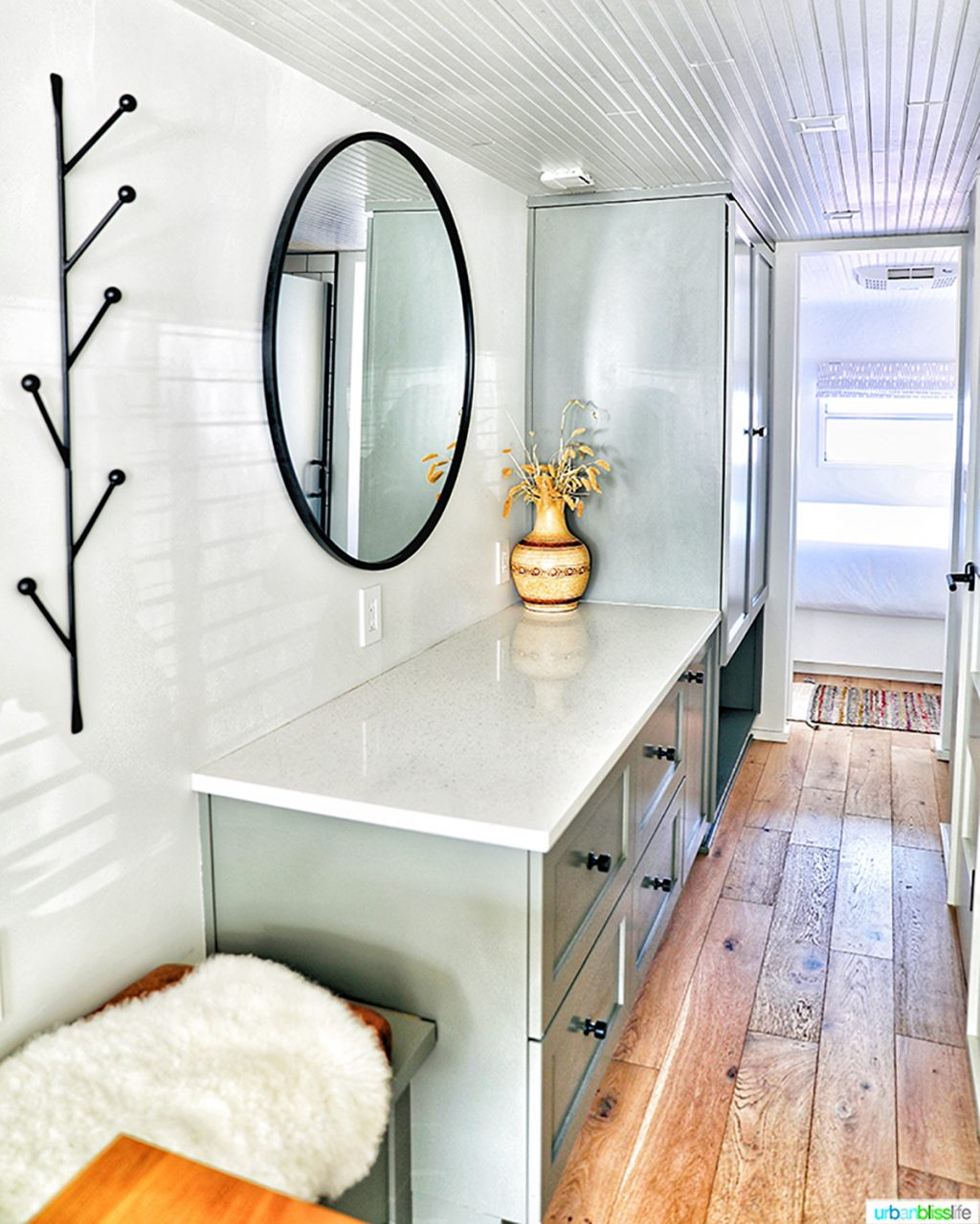 bright white and grey hallway with drawers in mansion airstream