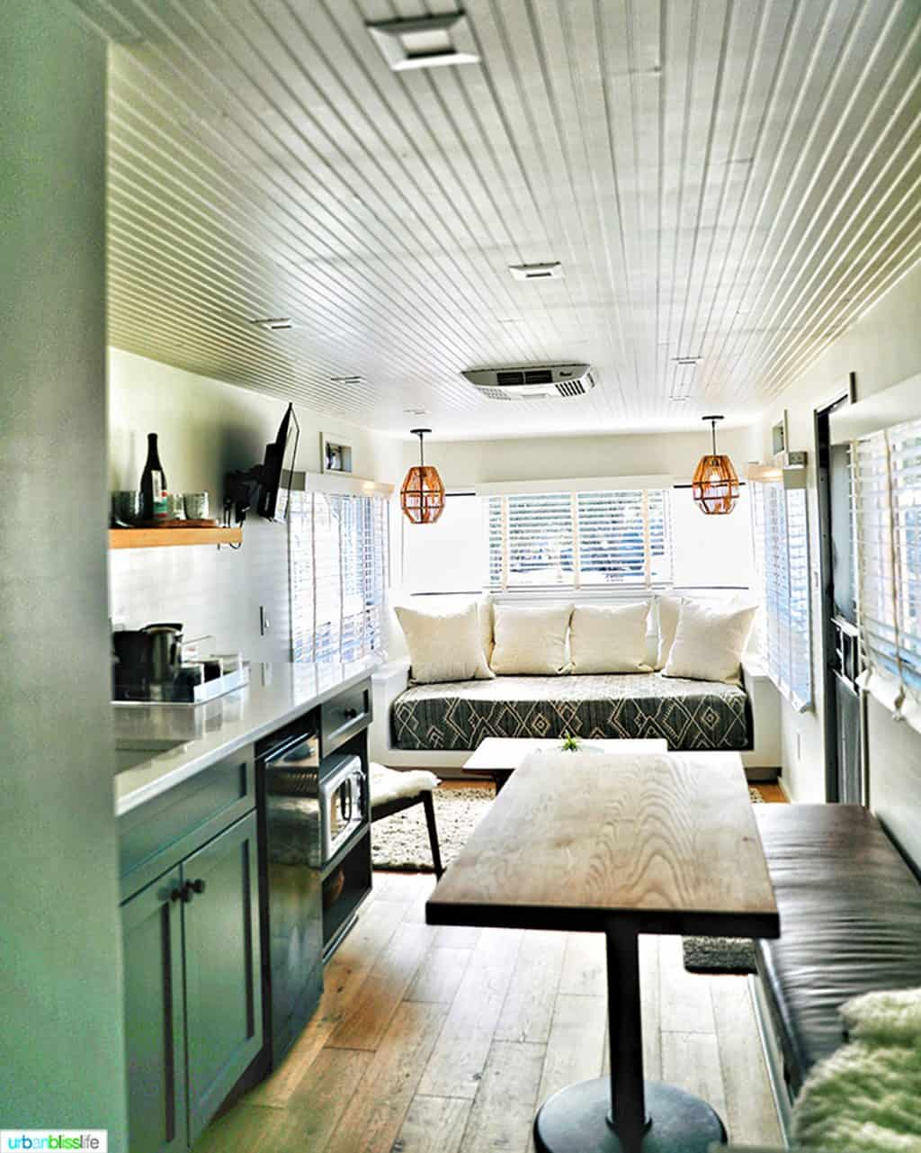 sitting area and kitchenette in vintages trailer resort mansion airstream