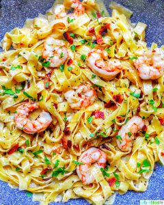 full photo of bacon shrimp pasta in pan