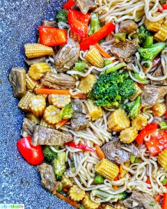 half side of beef lo mein in pan